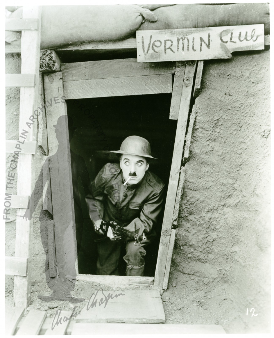 http://www.charliechaplinarchive.org/en/collection/cerca/trench-exterior-vermin-club-charles-chaplin-with-rifle/search/search:charlot/view_as/grid/page/2